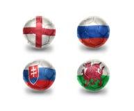 Eurogruppe B Fußballbälle mit Staatsflaggen von England, Russland, Slowakei, Wales Stockfotografie
