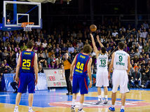 Euroleague basketball match. BARCELONA - MARCH 24: Dimitris Diamantidis shoots for a point during the Euroleague basketball match between Barcelona and royalty free stock photography
