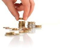 Euromünze in der Hand. Stockfoto