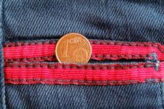 Euromünze mit einer Bezeichnung von einem Eurocent in der Tasche von Lizenzfreie Stockfotografie