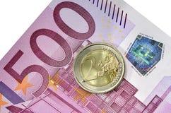 Euromünze und Banknote Stockfoto