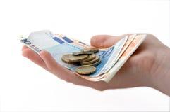 Euromünzen und Banknoten in der Hand Lizenzfreies Stockfoto