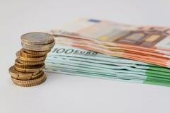 Euromünzen und einige Banknoten Lizenzfreie Stockfotos