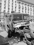Euromaidan, demolished riot control vehicle. KIEV, UKRAINE - AUGUST 4: Euromaidan, three days before the clashes and removal. Riot control vehicle demolished and Royalty Free Stock Image