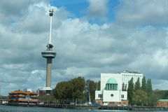 Euromast in port of Rotterdam, a touristic place. On the Quay is also the air cleaning installation of the Maastunnel. Netherlands in blue sly with cloudsn Royalty Free Stock Photography