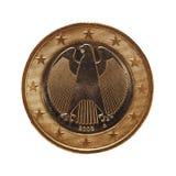 1 euromynt, europeisk union, Tyskland som isoleras över vit Arkivbild