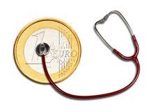 Euromynt och stetoskop Royaltyfri Foto