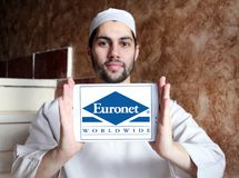 Euronet Worldwide financial services company logo. Logo of Euronet company on samsung tablet holded by arab muslim man. Euronet Worldwide is a US provider of stock image