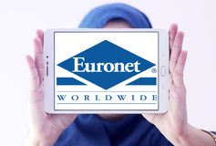 Euronet Worldwide financial services company logo. Logo of Euronet company on samsung tablet holded by arab muslim woman. Euronet Worldwide is a US provider of stock image