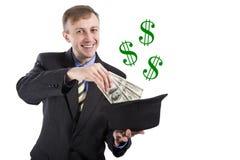 europäisch Weißer Mann, der Magie tut Dollar fliegen aus dem Hut heraus ISO Stockbilder