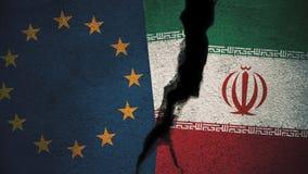 Europäische Gemeinschaft gegen der Iran-Flaggen auf gebrochener Wand Stockbilder