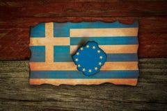 Europé och grekiskt flaggabegrepp fotografering för bildbyråer