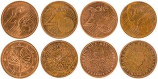 Europén 2 centmynt beklär och isolerade tillbaka på den vita backgroen Arkivfoton