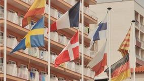 Europ?ische Flaggen auf der Stra?e in Calella spanien stock footage