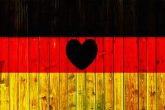 Europa för nationell för land för Tysklandflaggasymbol textil för bakgrund patriotisk tyskt trästaket Heart Arkivfoton