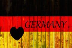 Europa för nationell för land för Tysklandflaggasymbol textil för bakgrund patriotisk tyskt trästaket Heart Royaltyfri Foto