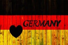 Europa för nationell för land för Tysklandflaggasymbol textil för bakgrund patriotisk tyskt trästaket Heart Royaltyfria Bilder