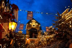Europa Park entrance in Christmas spirit by night. The main street of Europa Park Rust, Germany, in Christmas spirit by night while snow is falling Stock Photography
