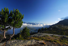 Europaweg. Morning view of trees and cloudy mountains on the Europaweg Royalty Free Stock Photography