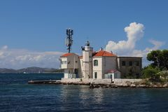 Europe. Adriatic seaof Mediterranean area. Dalmatian region. Croatia. Outpost of a maritime port with a beacon near Sibenik city. royalty free stock photos