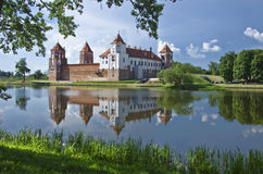 Europe, Belarus, history: Mir Castle Complex. Medieval castle in the settlement of Mir of the Grodno region. Fine stone castle, picturesque reservoir, coast Royalty Free Stock Photo