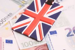 Europe, Brexit or Britain economy or financial concept, Closed up of Union Jack UK national flag on pile of Euro banknotes money stock photos