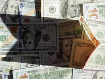 Dollars in the shadow of the Euro illuminated by the sun royalty free stock images
