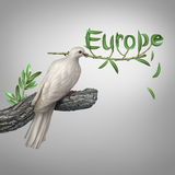 Europe Conflict. And diplomatic crisis concept as a white dove holding an olive branch with the leaves shaped as text as a hope and risk symbol for peace and Royalty Free Stock Photos