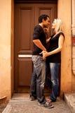 Europe Couple Flirt. An attractive couple flirting in an outdoor European setting stock photos