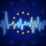 Europe Crisis. Concept and European union challenges symbol with an ECG or EKG monitor lifeline over a flag icon as a metaphor for political relationships and Royalty Free Stock Images