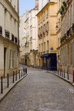 Europe Deserted Street in Paris. A quaint, deserted cobbblestone street in Paris Royalty Free Stock Photography