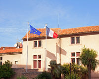 Europe and European Union flags on the background of the house a Royalty Free Stock Photography