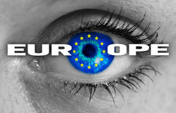 Europe eye looks through flag concept Stock Photography