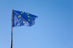 Europe flag on blue sky. Copy-space on the right Stock Image