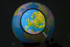 Europe in focus. Magnifying glass focusing on Europe Stock Image