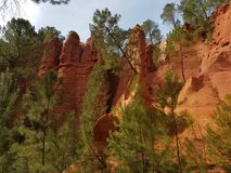 Europe. France. Ochre riffs of Roussillon. South region. Yellow-red rocks in France. stock photo