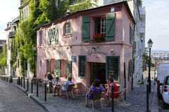 Europe, France, Paris, Montmartre, La Maison, Rose French Cafe - Rue de l'Abreuvoir, People walking on street and car parked on st Royalty Free Stock Photography