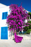 Europe Greece Santorini travel vacation. Woman in blowing dress Stock Images