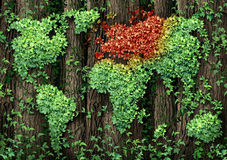 Europe Growth Crisis. Concept with a forest of tall trees with a green leaf vine growing in the shape of the global world map with the European area in autumn Stock Photos