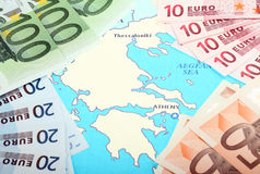 Europe helps Greece. Euro banknotes on map of Europe around Greece Stock Photos