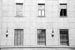 In europe italy milan o ld architecture and venetian blind wall Stock Photos