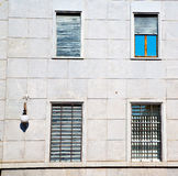 In europe italy  old architecture and venetian blind wall Royalty Free Stock Image