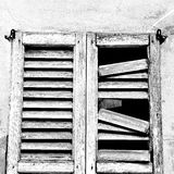 In europe italy  old architecture and venetian blind wall Royalty Free Stock Photo