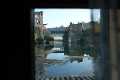 Italy, verona, borghetto sul mincio, view of the Visconti bridge from inside a house. Europe, Italy, Veneto, Verona, Valeggio, Borghetto sul Mincio, a glimpse of Stock Photos