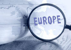 Europe map through magnifying glass. Royalty Free Stock Photos