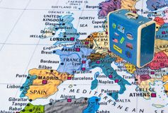 Europe map and travel case with stickers my photos. Europe map and case with stickers my photos - travel background royalty free stock images