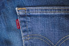 EUROPE, 9 March 2018 - Europe threatens tariffs on US jeans as trade war looms. Photo manipulated image of jeans with red Levis label adapted to read Evils Stock Photography