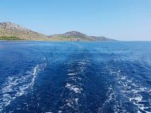 Europe. Mediterranean area. Adriatic sea. Croatian riviera. Dalmatian region. Watertrack on the sea. Weather in sunny day. Kornati. National park. Blue sky with royalty free stock image
