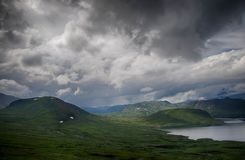 Mountain nature landscape in Morway summer. Europe nature - lakes mountains and sky for hiking Stock Image