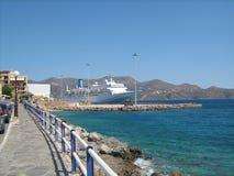 Europe, Nikolas, Greece, Crete. Ferry. Sea. Beach. Blue sky. Mountain Stock Image